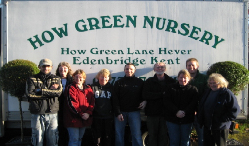 The How Green Team members in front of one of the vans