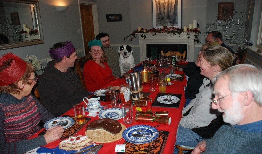The How Green team sitting around the dining room table having their staff Christmas meal